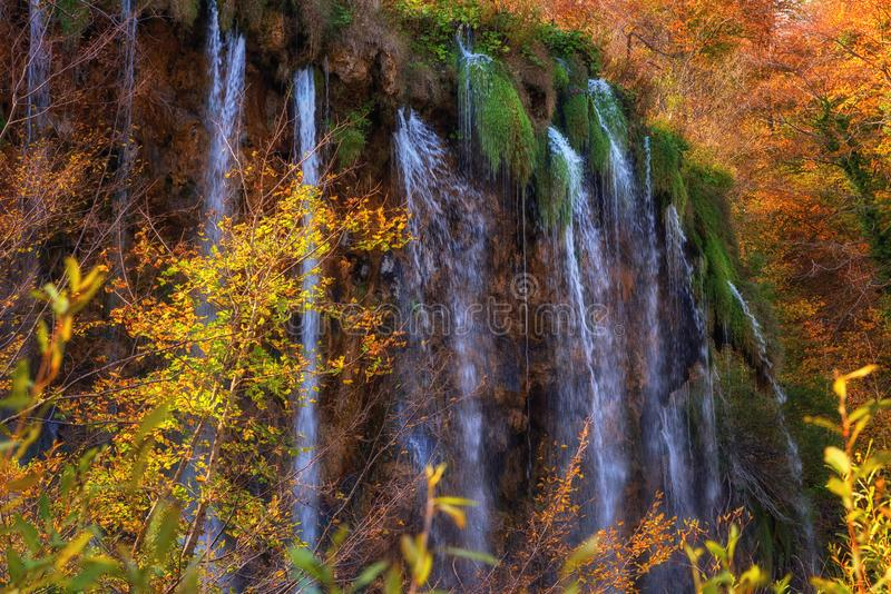 Plitvice lakes Plitvicka jezera national park, Croatia. Amazing autumn sunny landscape. With waterfall and colored trees, Prstavac. Outdoor travel background royalty free stock photos