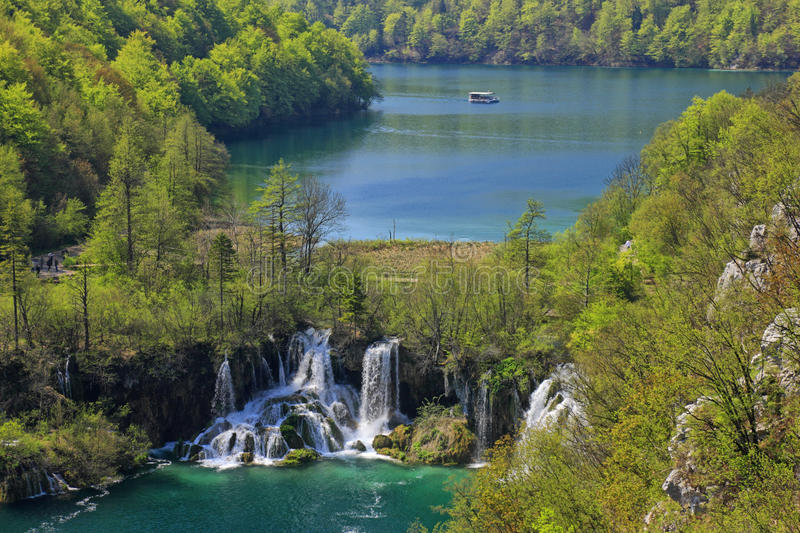 Plitvice lakes. Waterfalls and boat. National park Plitvice lakes in Croatia stock photo