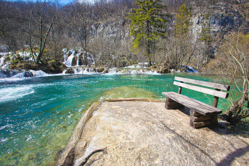 Plitvice national park. Wooden bench at the Plitvice National Park lakes and waterfalls stock images