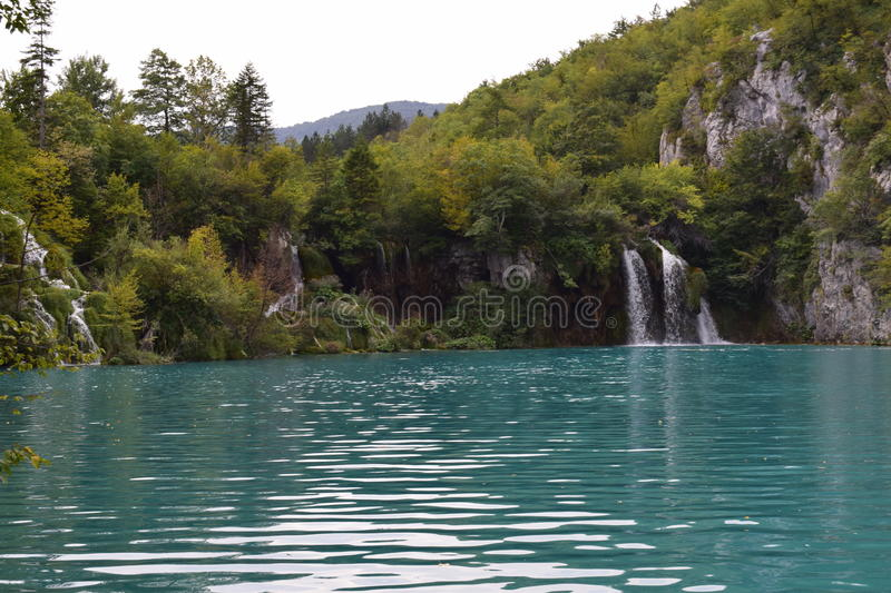 Plitvice National Park. Turquoise lake and waterfall from inside Plitvice national park, Croatia royalty free stock images