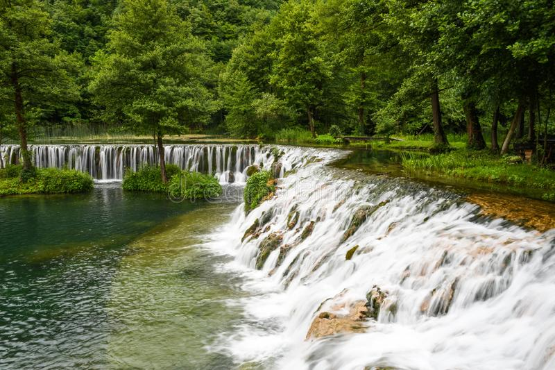 Pliva waterfalls in a raining summer day stock images