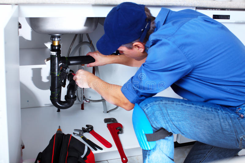 Plombier professionnel. images libres de droits