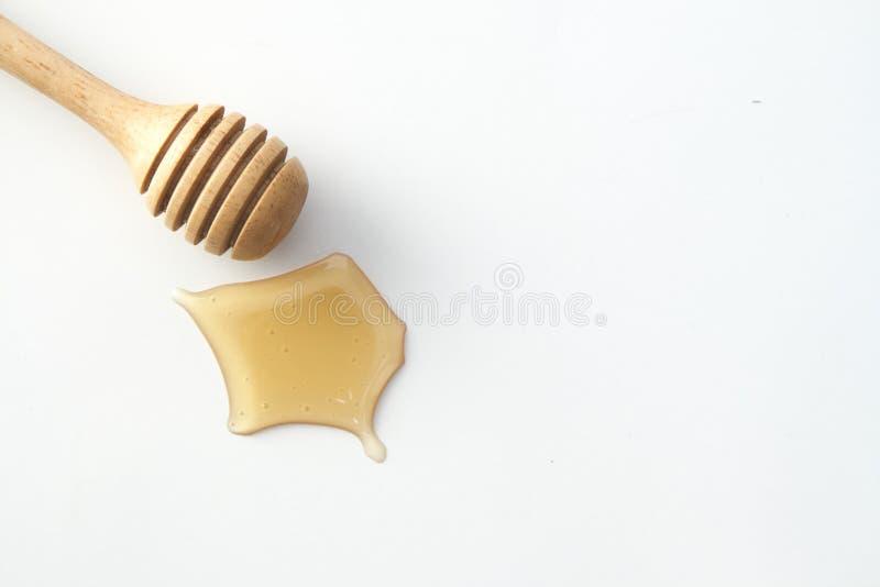 Plongeur de miel et bouteille de miel photographie stock
