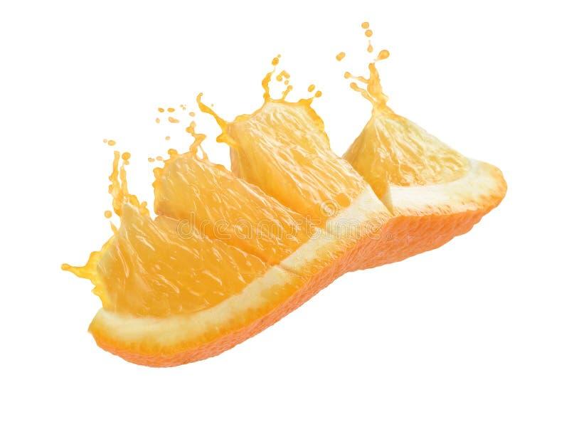 Plons van jus d'orange met een plak van sinaasappel stock fotografie