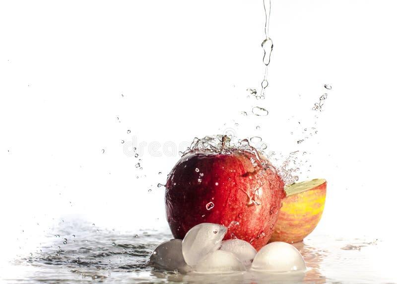 Plonswater op appelen stock fotografie