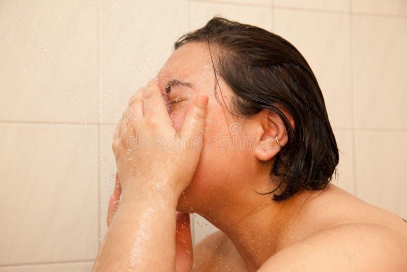 Plonswater op uw gezicht stock foto's