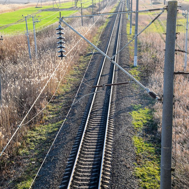 Plot railway. Top view on the rails. High. Voltage power lines for electric trains stock photography