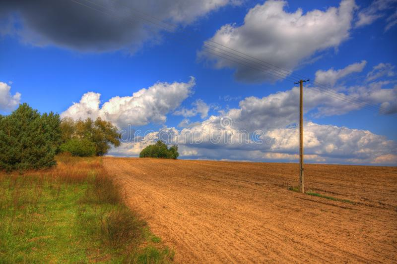 Ploughed field at late summer. HDR image. Poland, The Holy Cross Mountains stock images