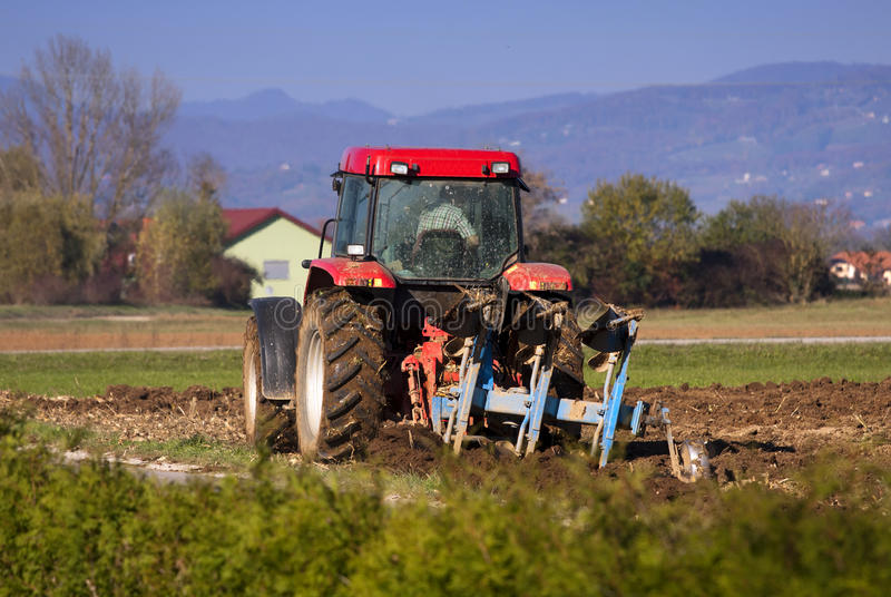 Ploughing. Framer ploughing with the tractor on the autumn fields royalty free stock images
