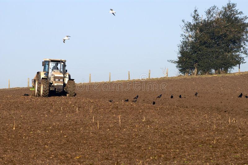 Ploughing. Tractor ploughing winter field in Shropshire, UK stock image