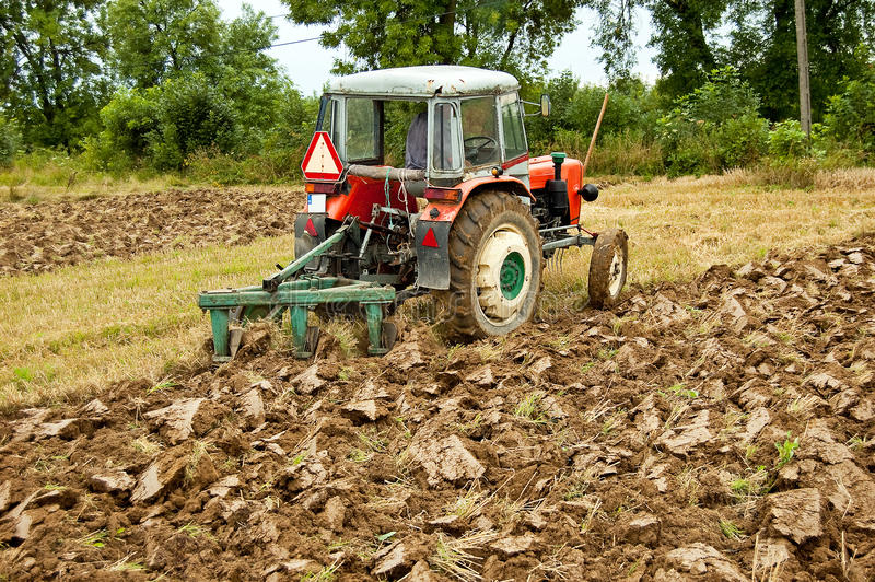 Ploughing field. On old tractor in southern Poland royalty free stock image