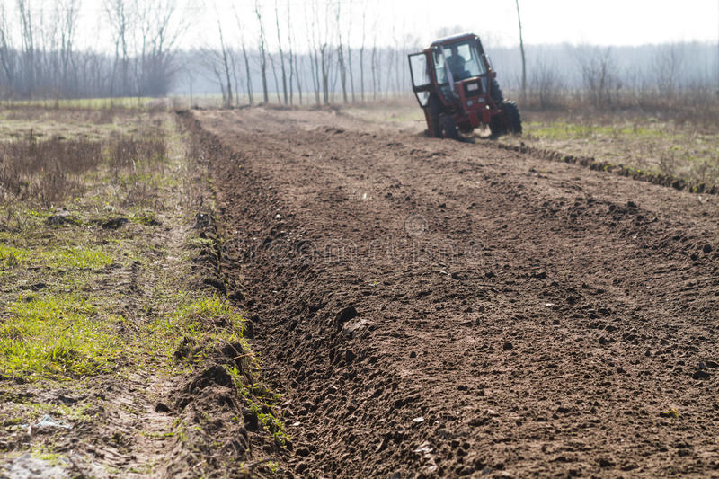 Ploughing in the fields. In spring stock image