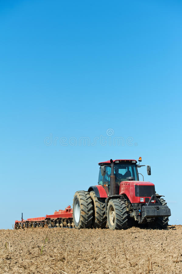 Download Ploughing Tractor At Field Cultivation Work Royalty Free Stock Photos - Image: 20957678