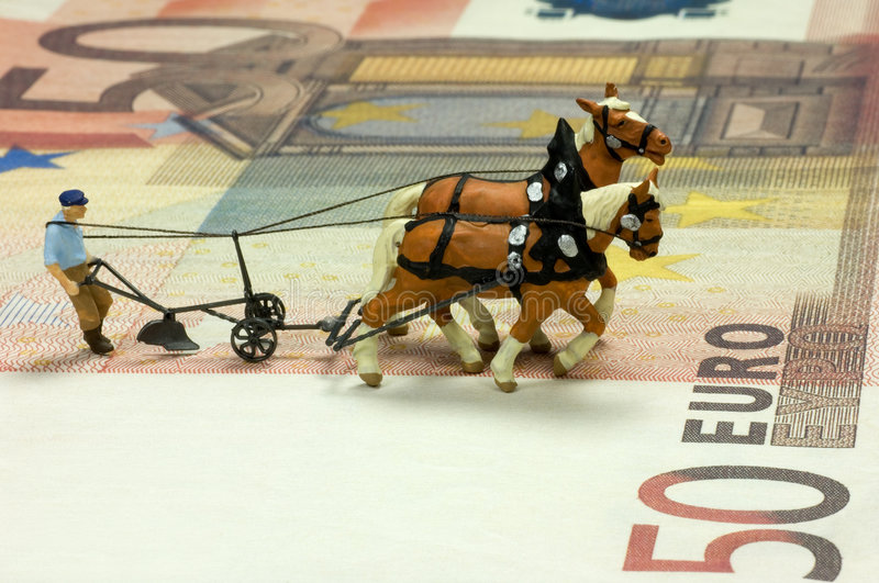 Ploughman. Miniature figure of a ploughman with two horses on a fifty Euro bill. With space for copy stock photography