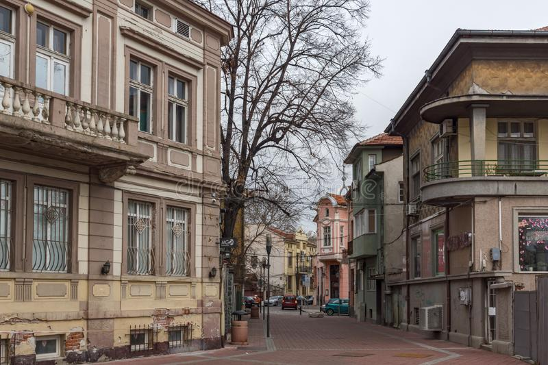 Typical street and buildings in the center of city of Plovdiv, Bulgaria. PLOVDIV, BULGARIA - DECEMBER 30, 2016: Typical street and buildings in the center of stock images
