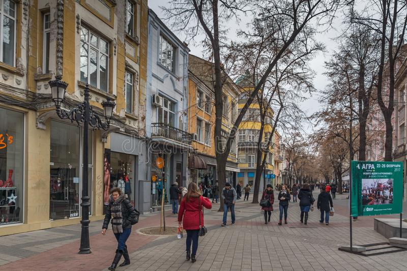 Walking people and Houses at central street in city of Plovdiv, Bulgaria. PLOVDIV, BULGARIA - DECEMBER 30, 2016: Walking people and Houses at central street in royalty free stock image