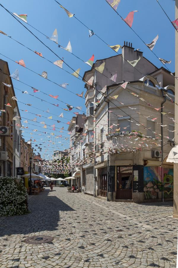 Street and houses in district Kapana, city of Plovdiv, Bulgaria. PLOVDIV, BULGARIA - JULY 5, 2018: Street and houses in district Kapana, city of Plovdiv royalty free stock image