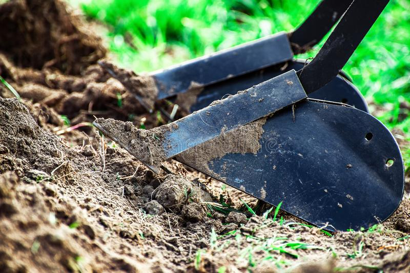 Plow and dug up soil. With shallow depth of field royalty free stock images