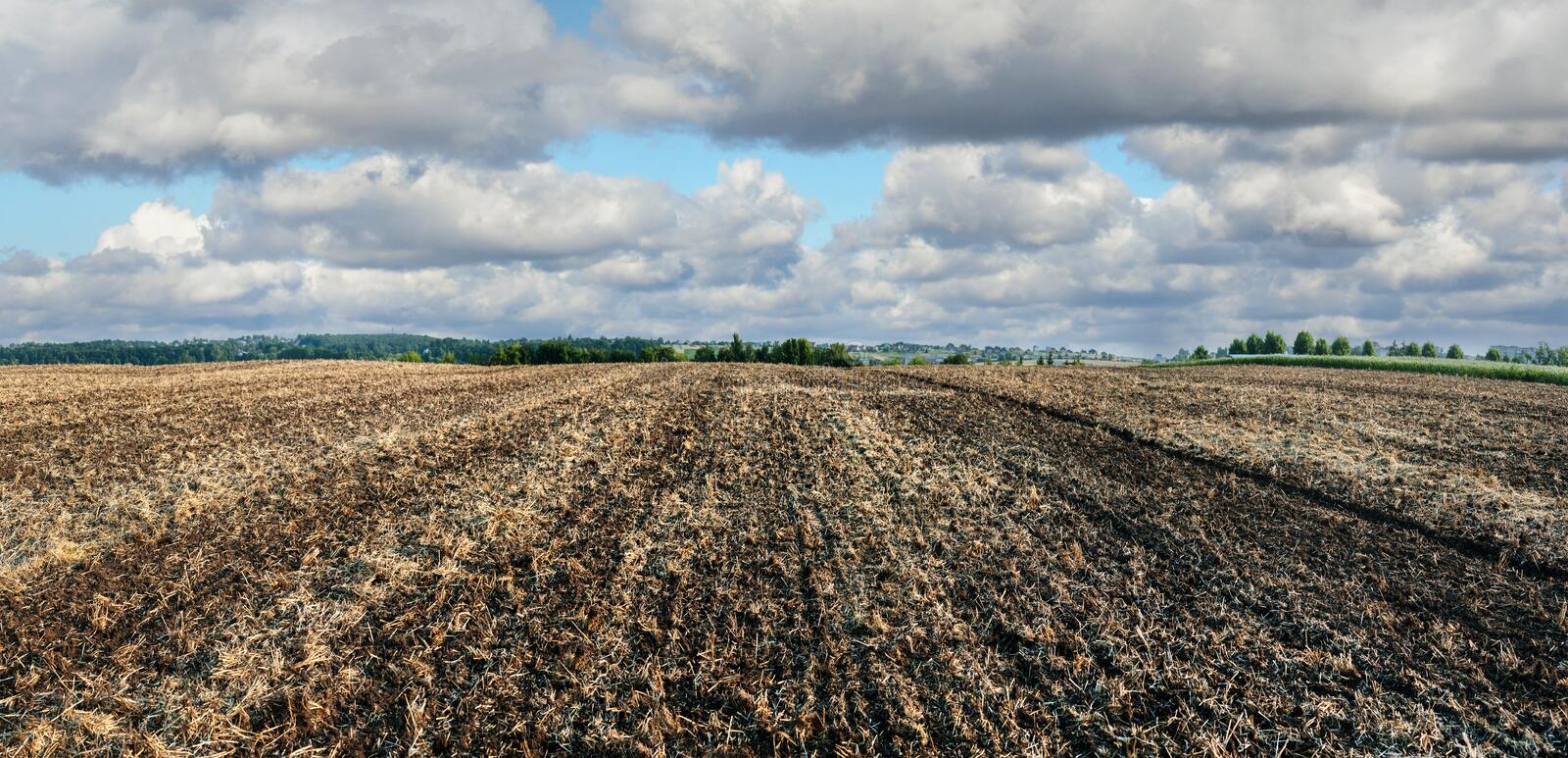Plowed farmlands, arable fields with cloudly sky. Plowed farmlands, arable fields with beautiful sky stock image