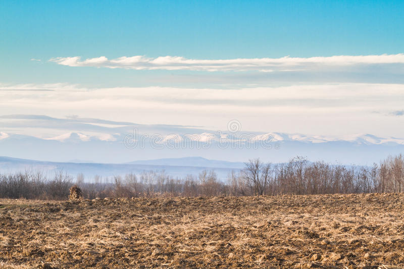 Plowed field in winter afternoon royalty free stock image
