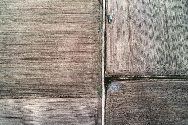 Plowed fiels and road in top view stock image