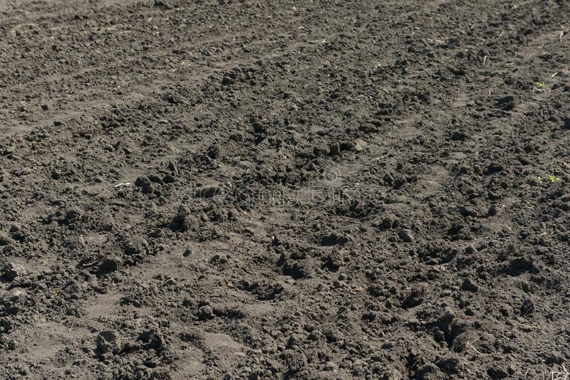 Plowed land with furrow lines. Photos of chernozem stock photos
