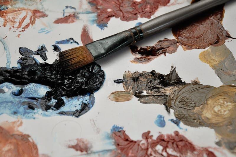 Pluśnięcia farba z paintbrush fotografia stock
