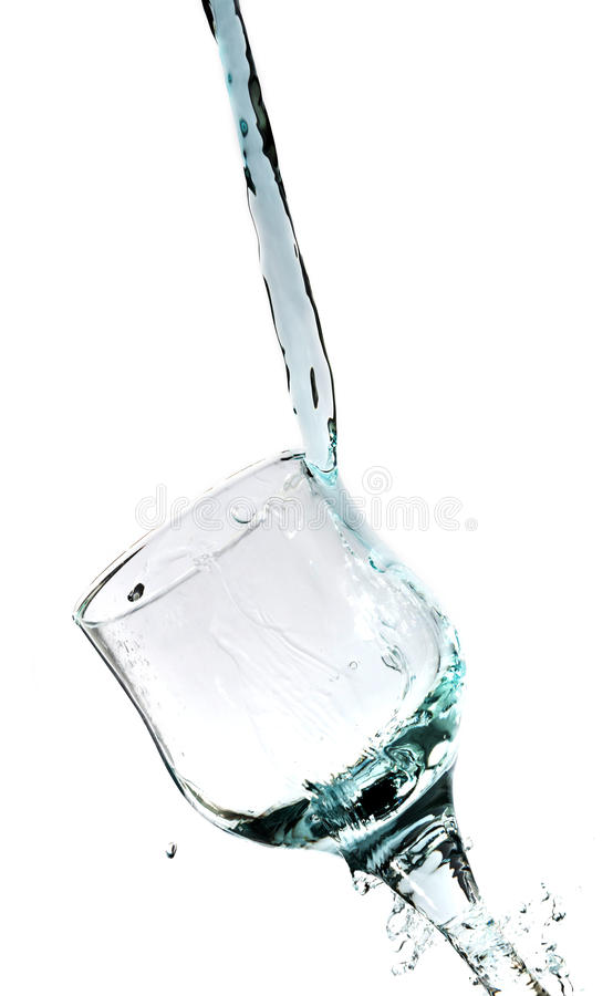 Pluśnięcie błękitne wody w szkło zdjęcie royalty free