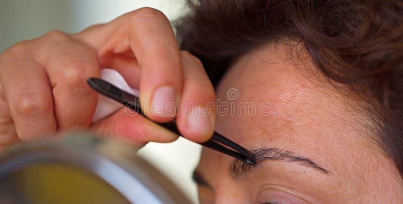 Download Plucking eyebrows stock photo. Image of make, hand, eyebrows - 25737070