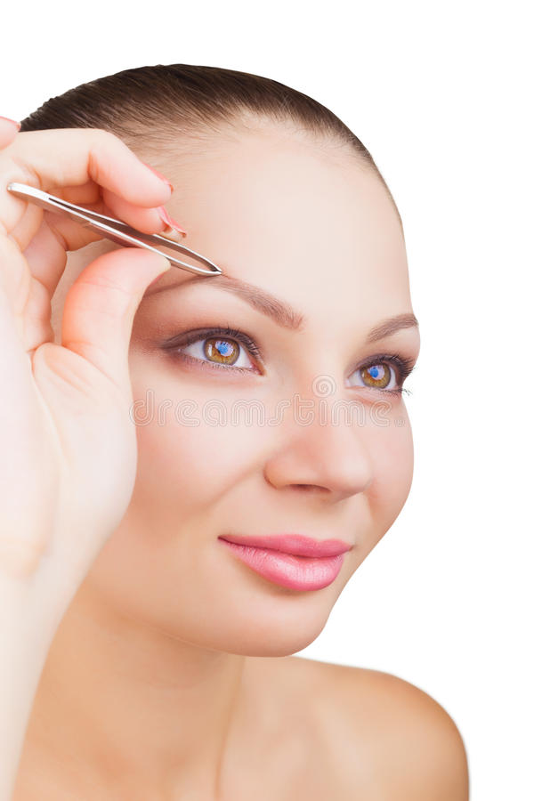 Download Plucking eyebrows stock photo. Image of attractive, brow - 26379650