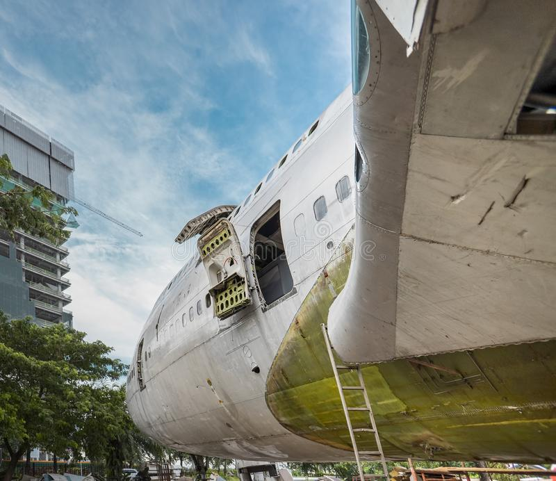 Plug Door of Big Jumbo Jetliner Aircraft Are Being Repaired or Under Maintenance at Open Air Hangar. Airplane Cut To Pieces and Dismantle For Recycling at royalty free stock photos