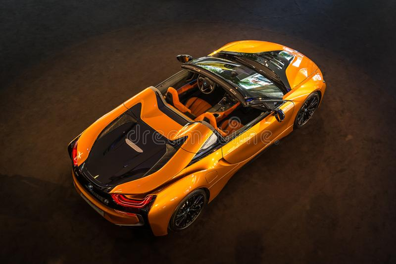 A plug-in hybrid sports car BMW i8 Roadster. BERLIN - JUNE 09, 2018: Showroom. A plug-in hybrid sports car BMW i8 Roadster. View from above stock photography
