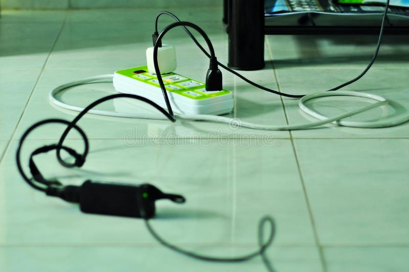 The plug and the power cord that is plugged royalty free stock image
