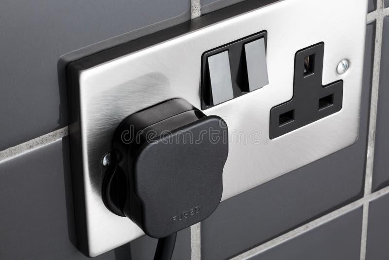Plug socket in kitchen royalty free stock image