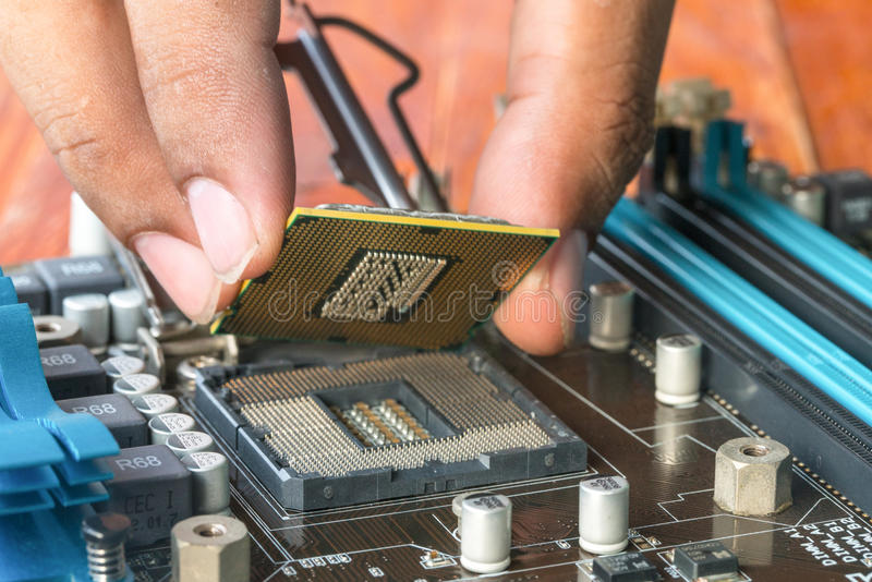 Plug technicians microprocessor motherboard CPU socket. 1 2 3 4 stock images
