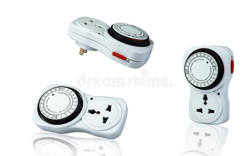 Plug-in timer mechanical 24 hour. Indoor home tools. Plug-in timer socket set isolated on white background. Mechanical outlet time stock photography