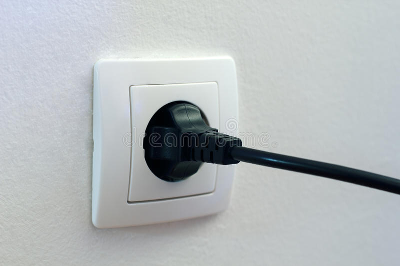 Plugged in socket stock photos