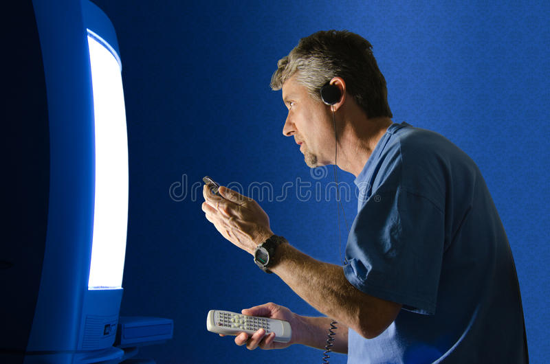 Plugged In & Tuned Out - Technology Overdose Stock Photography