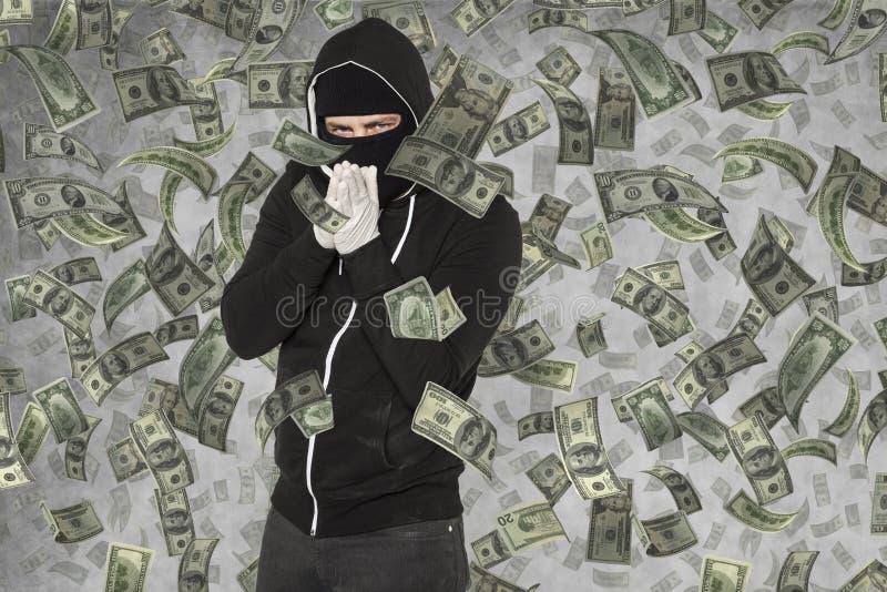 Pluies d'argent sur le pickpocket photographie stock