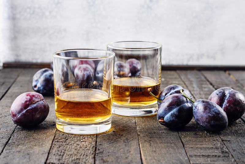 Plum alcoholic drink. Brandy Slivovica, and plum fruit stock image