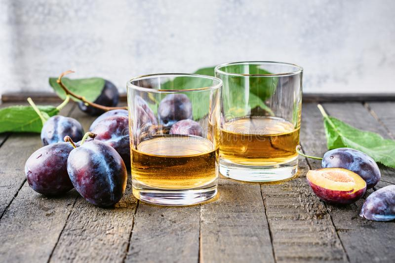 Plum alcoholic drink. Brandy Slivovica, and plum fruit royalty free stock image