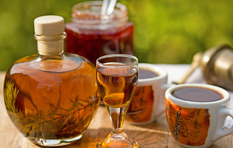 Plum brandy and coffee stock image