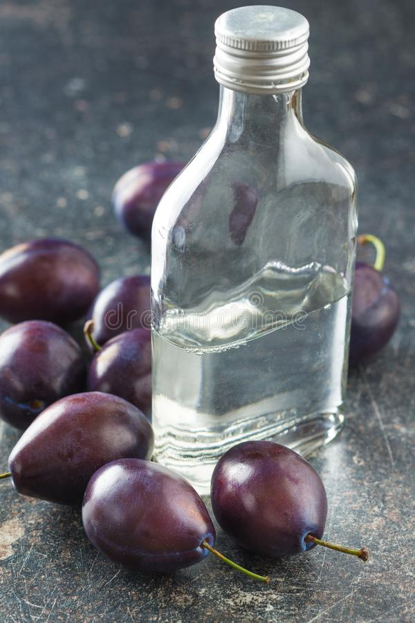 Plum brandy and plums. royalty free stock photos