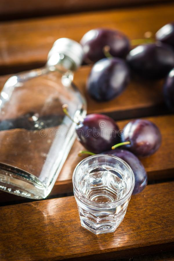Plum brandy and plums. stock photos