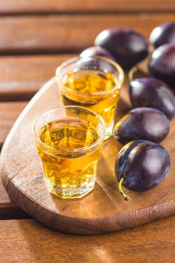 Plum brandy and plums. Tasty slivovitz stock images