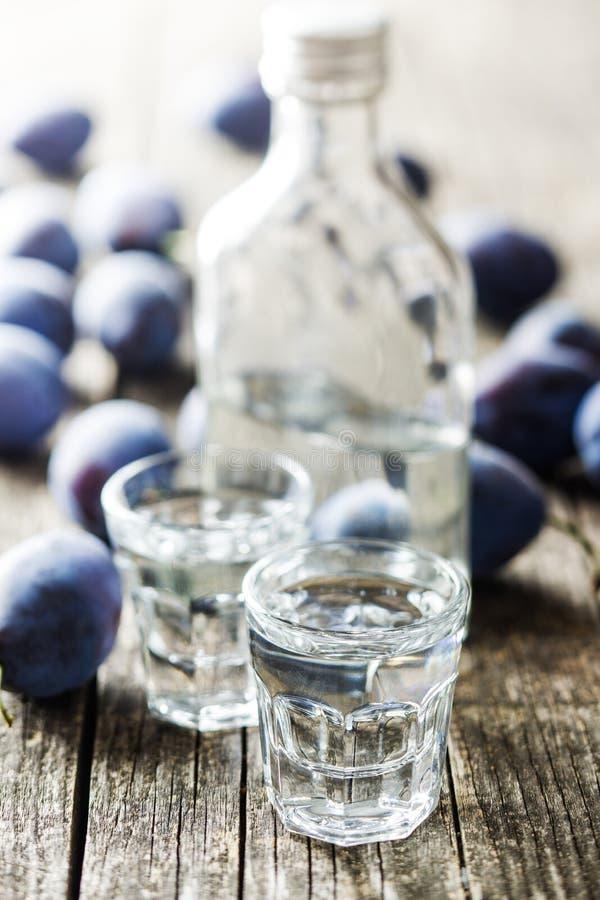 Plum brandy and plums. Tasty slivovitz stock photo