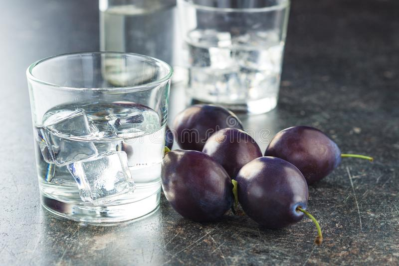 Plum brandy and plums. stock image
