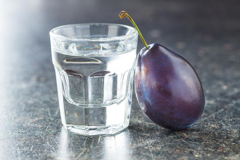 Plum brandy and plums. stock images