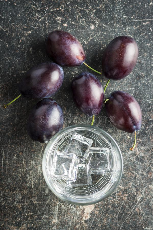 Plum brandy and plums. royalty free stock images