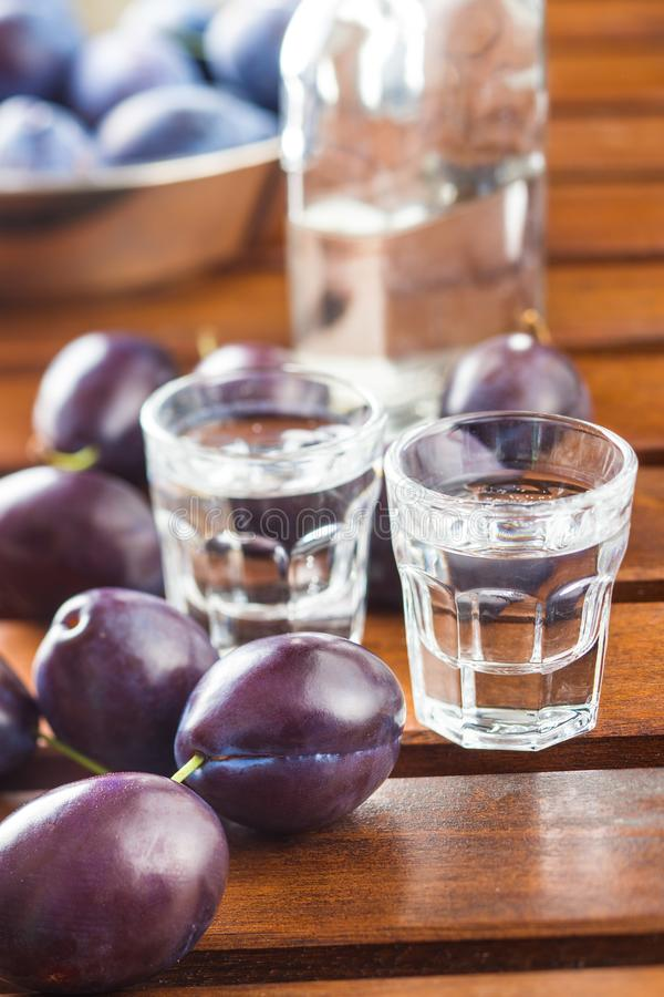 Plum brandy and plums. royalty free stock image